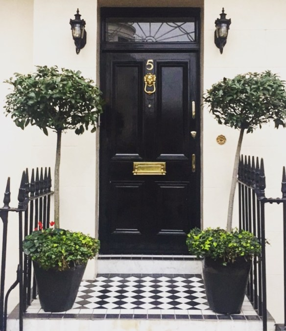 Black front door in London photo by Christina Dandar for The Potted Boxwood
