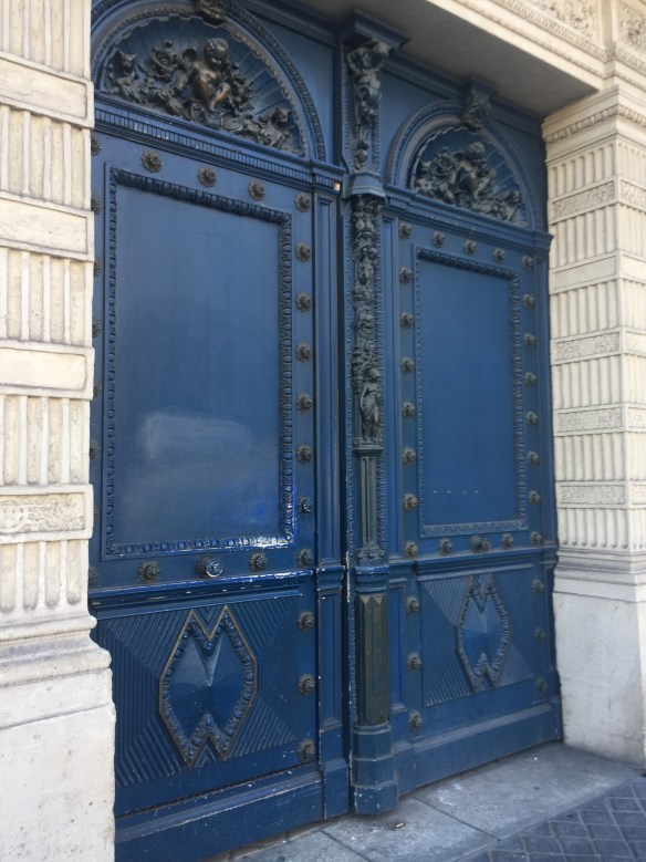 Blue doors in Paris photo by Christina Dandar for The Potted Boxwood