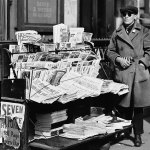 """This blind news vendor has April 1926 issues of """"Detective Story Magazine,"""" """"Western Story Magazine,"""" and """"Short Stories"""" for sale."""