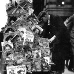 """Pulps and a few """"slicks"""" are clipped to the side of this magazine rack in New York City in November 1932."""