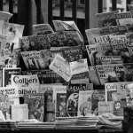 """A woman makes a purchase at a New York newsstand in May 1936. Check out the pulp titles: """"Short Stories"""" (May 10, 1936), """"Spicy Detective"""" (June 1936), """"Detective Fiction Weekly"""" and """"Western Story Magazine."""""""