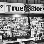 """Beneath advertising for """"Liberty,"""" """"True Story,"""" and """"True Detective"""" magazines, this magazine rack displays a number of pulp magazines from early 1938."""