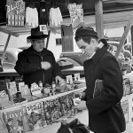 A man makes a purchase at a newsstand in Burbank, Calif., in early 1941. Pulps dated February 1941 are on display.