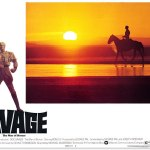 Doc Savage (Ron Ely) rides across a desert in the Republic of Hidalgo in George Pal's 1975 film, Doc Savage: The Man of Bronze.