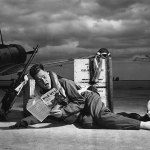 """Here's a photo staged at the Harlingen Army Gunnery School, Texas, in March 1943. The caption reads: """"Although the aerial gunner reputedly has one of the most exciting jobs in the Army Air Forces, it is just commonplace stuff to Staff Sgt. Millard W. Reynolds of Chattanooga, Tenn., an instructor at the Harlingen Army Gunnery School. But let him get his feet on the ground, and his hands on a magazine of Western stories, and the former bank teller really is thrilled. Look at him now!"""" SSgt. Reynolds is reading the Oct. 31, 1942, number of """"Wild West Weekly."""""""