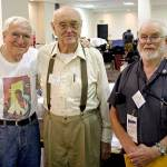 """Pulpcon veterans Al Tonik, from left, Wooda """"Nick"""" Carr and Ray Beam visit Friday morning shortly after doors to the dealers' room open."""