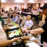 Ron Hanna, left, of Wild Cat Books, talks with a customer about the second edition of Jay Ryan's The Handbook of Bronze.