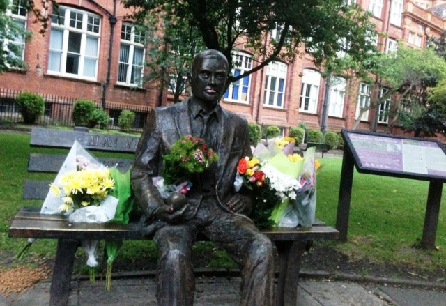Flowers_on_Alan_Turing's_Memorial,_as_an_early_part_of_the_flowers_for_Turing_Project. - by Joseph Reddington