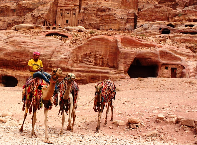Petra tombs and camel rider at sunset - photo zoedawes