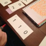 Trying to show 110 with place value cards