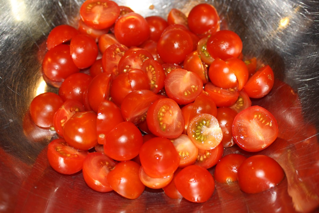 cherry tomatoes halved in bowl