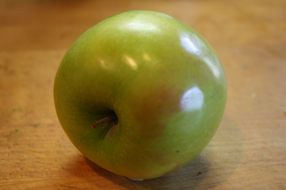 one whole green apple