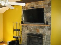 Canaan, CT  TV Install on natural stone above fireplace ...
