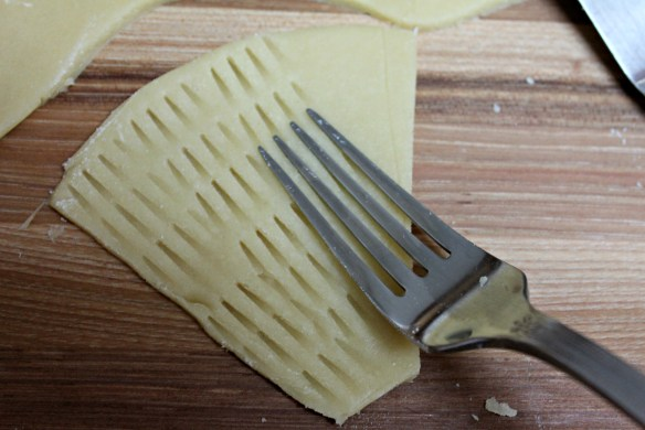 Cut out shape by cutting around template with sharp knife. Press fork tines in one direction...