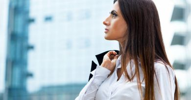 35460467 - portrait of a woman holding a jacket on her shoulder