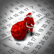 34381762 - christmas time holiday concept as santa clause with a gift bag standing on top of a group of month calendar sheets as a  winter and new year celebration symbol.