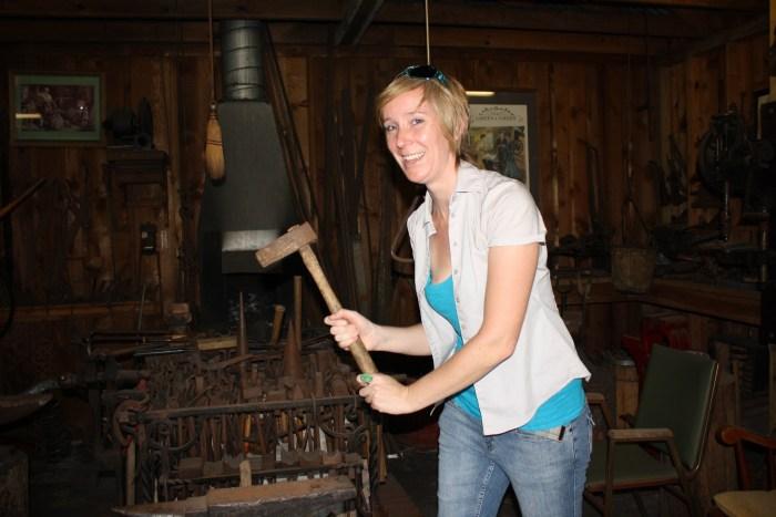 Aefa Mulholland picks up the wedding anvil at Gretna Green smithy, Gretna, Louisiana