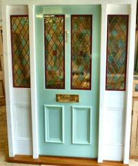 A Stained Glass Front Door With Frame And Sidelights ...