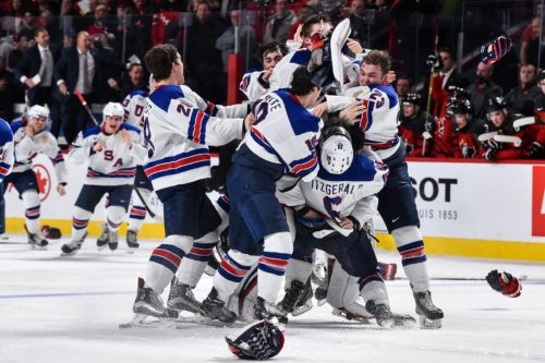 The United States players celebrate after Troy Terry scored the only goal in the shootout to give the Americans a 5-4 win over Canada in the gold-medal game of the world junior championship.
