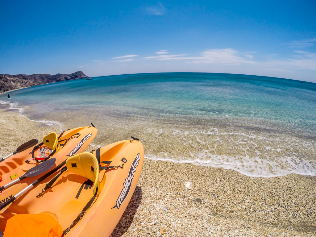 Sea kayaking on the island of Milos, Greece