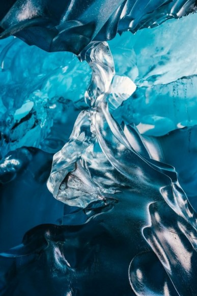 Wednesday 25th November 2015, Vatnajökull national park, Iceland: Photographer Mikael Buck with assistance from renowned local Icelandic guide Einar Runar Sigurdsson, explored the frozen world of Vatnajökull glacier in Iceland using Sony's world first back-illuminated full-frame sensor – which features in the ?7R II camera. His images were taken without use of a tripod or any image stitching techniques in photoshop. This was made possible through Sony's new sensor technology, allowing incredibly detailed low-light hand held photography. Previously images this detailed would have required carrying bulky equipment to the caves, some of which can require hiking and climbing over a glacier for up to two hours to to access. This picture: Inside the 'ABC cave' - which stands for Amazing Blue Cave. For further information please contact Rochelle Collison at Hope & Glory PR on 020 7014 5306 or rochelle.collison@hopeandglorypr.com Copyright: © Mikael Buck / Sony 07828 201 042 / mikaelbuck@gmail.com