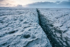Wednesday 25th November 2015, Vatnajökull national park, Iceland: Photographer Mikael Buck with assistance from renowned local Icelandic guide Einar Runar Sigurdsson, explored the frozen world of Vatnajökull glacier in Iceland using Sony's world first back-illuminated full-frame sensor – which features in the ?7R II camera. His images were taken without use of a tripod or any image stitching techniques in photoshop. This was made possible through Sony's new sensor technology, allowing incredibly detailed low-light hand held photography. Previously images this detailed would have required carrying bulky equipment to the caves, some of which can require hiking and climbing over a glacier for up to two hours to to access. This picture: On top of the Vatnajökull glacier PR Handout - editorial usage only. Photographer's details not to be removed from metadata or byline. For further information please contact Rochelle Collison at Hope & Glory PR on 020 7014 5306 or rochelle.collison@hopeandglorypr.com Copyright: © Mikael Buck / Sony 07828 201 042 / mikaelbuck@gmail.com