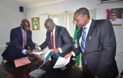 Immediate past EFCC Chairman, Ibrahim Lamorde, on Wednesday, November 11, 2015 officially handed over to the newly appointed acting chairman of the anti-graft agency, Ibrahim Mustapha Magu