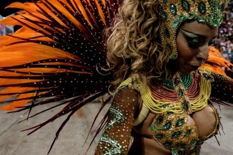 A reveller of Unidos da Tijuca samba school performs during the first night of the carnival parade at Sambadrome in Rio de Janeiro, Brazil on February 8, 2016. AFP PHOTO / YASUYOSHI CHIBAYASUYOSHI CHIBA/AFP/Getty Images