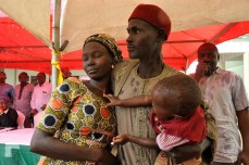 One of the recent released Chibok school girls with her relative and child at a special thanksgiving service held in Abuja on Sunday, October 16, 2016 | Fed. Min Of Information
