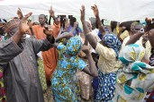 Some of the Chibok school girls and their parents and relatives recently released from captivity dancing at a special thanksgiving service held in Abuja on Sunday, October 16, 2016 | Fed. Min Of Information