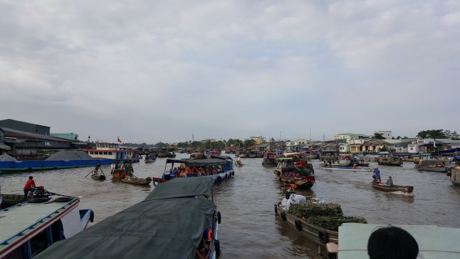 Vendors at the Floating Market at the Mekong Delta