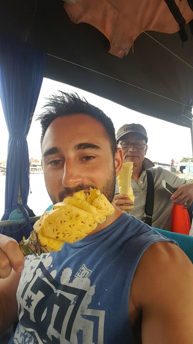 Fresh pineapple lolly on the Floating Market at the Mekong Delta