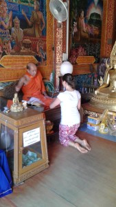 Sinzy getting blessed in Wat Prathat on the top of Doi Suthep