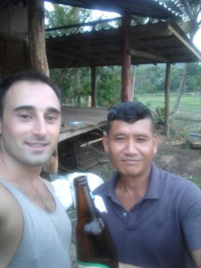 On my way to Pai, I stopped by a gate to photograph the mountains. This man owned the house and said not to mind the gate, that I could open it to get a better shot. He then invited me in for some Thai whiskey! Best people in the world!