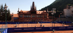 The Olympia Tennis club, at the foot of the Tampa Mountain in Brasov, majestically rustic against the old fortress walls.
