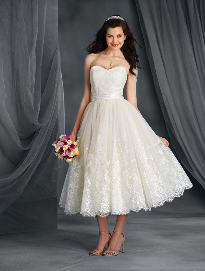 Alfred Angelo Retail Price: $850.00 Romantic satin and net ball gown with a softly scooped strapless neckline, embroidered lace overlay bodice and a pleated satin natural waistband. The full gathered net skirt features a dramatic lace applique hem and a tea length skirt.