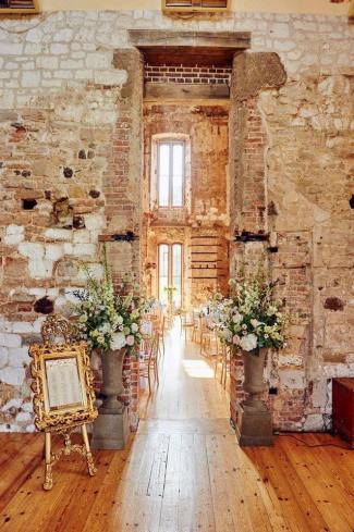 Our ornate gold easel and frame on hire at Lulworth Castle
