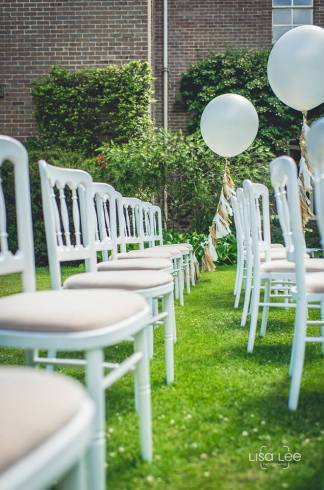 Our white cheltenham chairs with ivory seat pads on hire at Talbot Heath