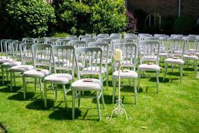 Our silver cheltenham chairs with ivory seat pads on hire at Talbot Heath