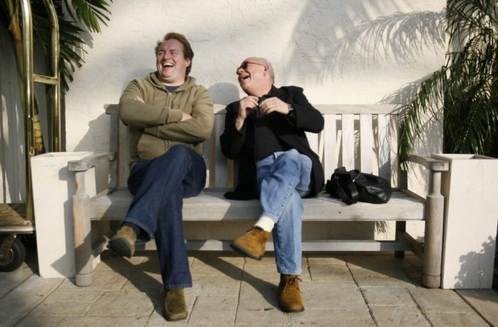 The Who's lighting director Tom Kenney (left) and onstage sound engineer Bob Pridden share a laugh while waiting for the ride to the airport in West Palm Beach, Fl during the 2006 tour.