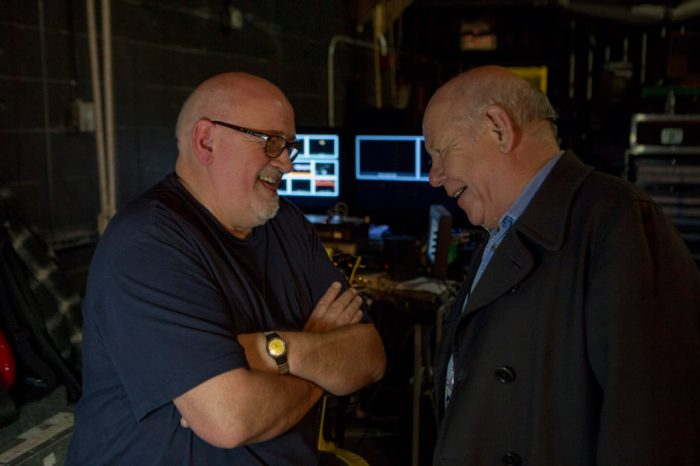 Pete Townshend guitar tech Alan Rogan chats with onstage sound engineer Bob Pridden prior to The Who and Elvis Costello and the Imposters performing at Madison Square Garden Theatre for Teen Cancer America.