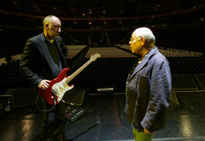 Onstage Sound Engineer Bob Pridden chats with The Who's Pete Townshend during a sound check at Wells Fargo Center, Des Moines, IA.