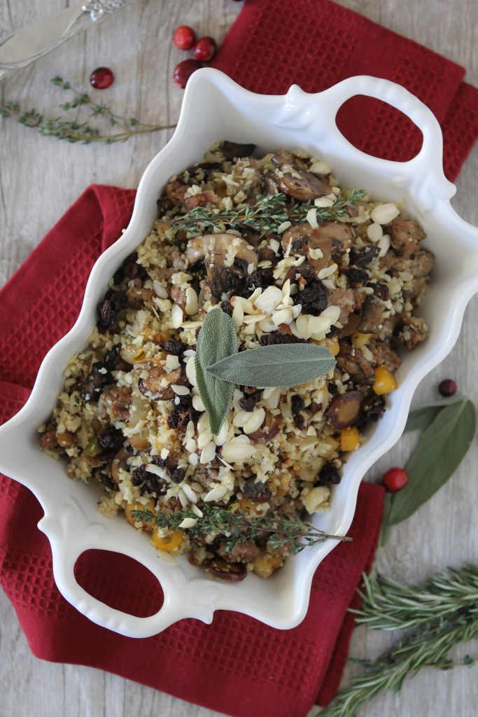 Cauliflower Rice Thanksgiving Stuffing from the Whole Smiths. a must have at any grain free Thanksgiving, it taste just like the real deal. Paleo friendly, gluten free and easy to make Whole30 compliant.