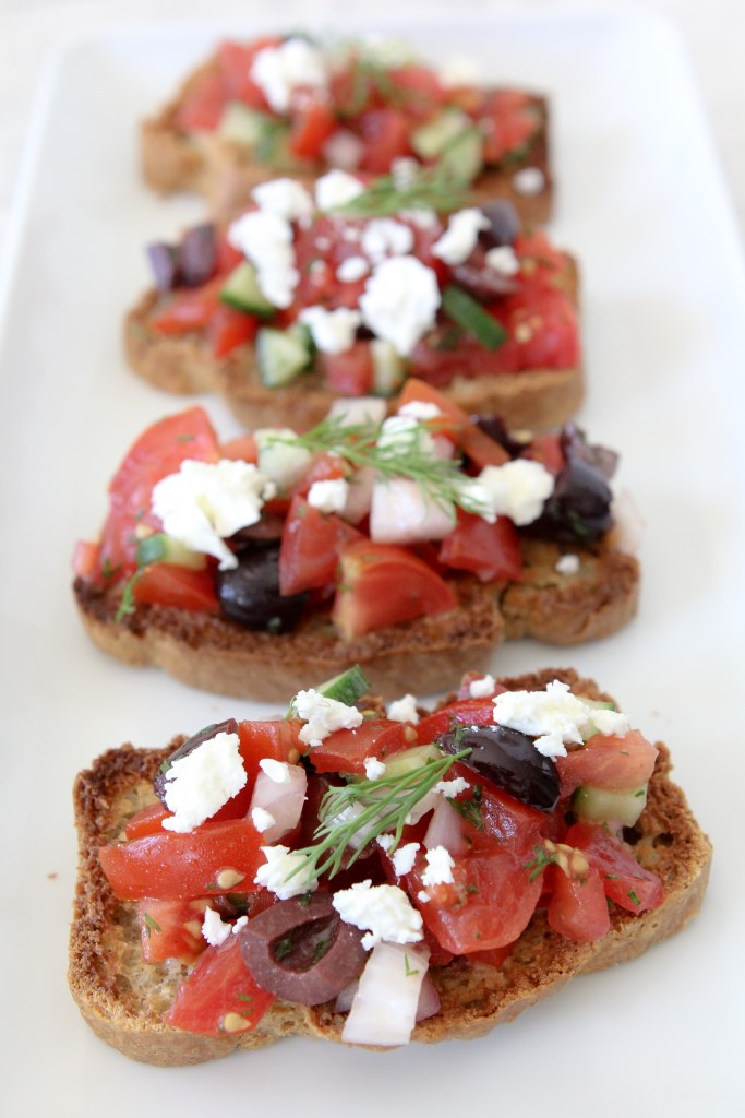 Grain-Free Greek Bruschetta from the Whole Smiths. A fresh twist on the classic using Simple Mills Artisan Bread Mix. Gluten and grain-free, paleo-friendly.