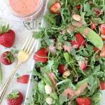 Strawberry Arugula Salad + Strawberry Champagne Dressing from the Whole Smiths. Paleo-friendly, vegan, gluten-free.
