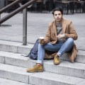 Menswear Blogger Ronan Summers snapped in Paddington for a project in collaboration with Urban Outfitters UK, styling a double breasted camel coat, jeans and suede desert boots