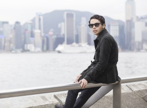 Fashion and lifestyle blogger from London, Ronan Summers is in Hong Kong, overlooking the Victoria Harbour and wearing an emerald Suede Jacket by Reiss SS16 collection