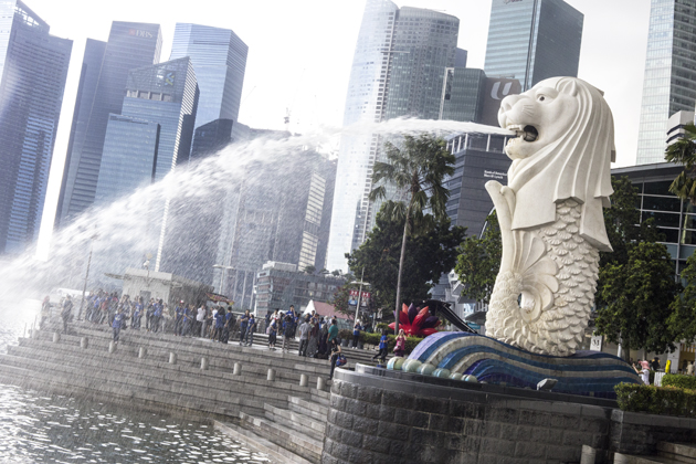 The Merlion and the Singapore skyline during the day