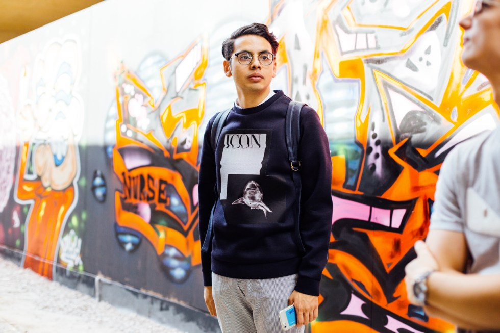 Menswear blogger Ronan Summers attending the Graffiti event with Farfetch and wearing Emporio Armani AW16 shark neoprene sweater