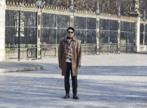 Menswear UK fashion blogger Ronan Summers photographed in Paris during mens fashion week in January 2017 wearing Burberry PVC trench coat and Daks multi coloured runway jumper